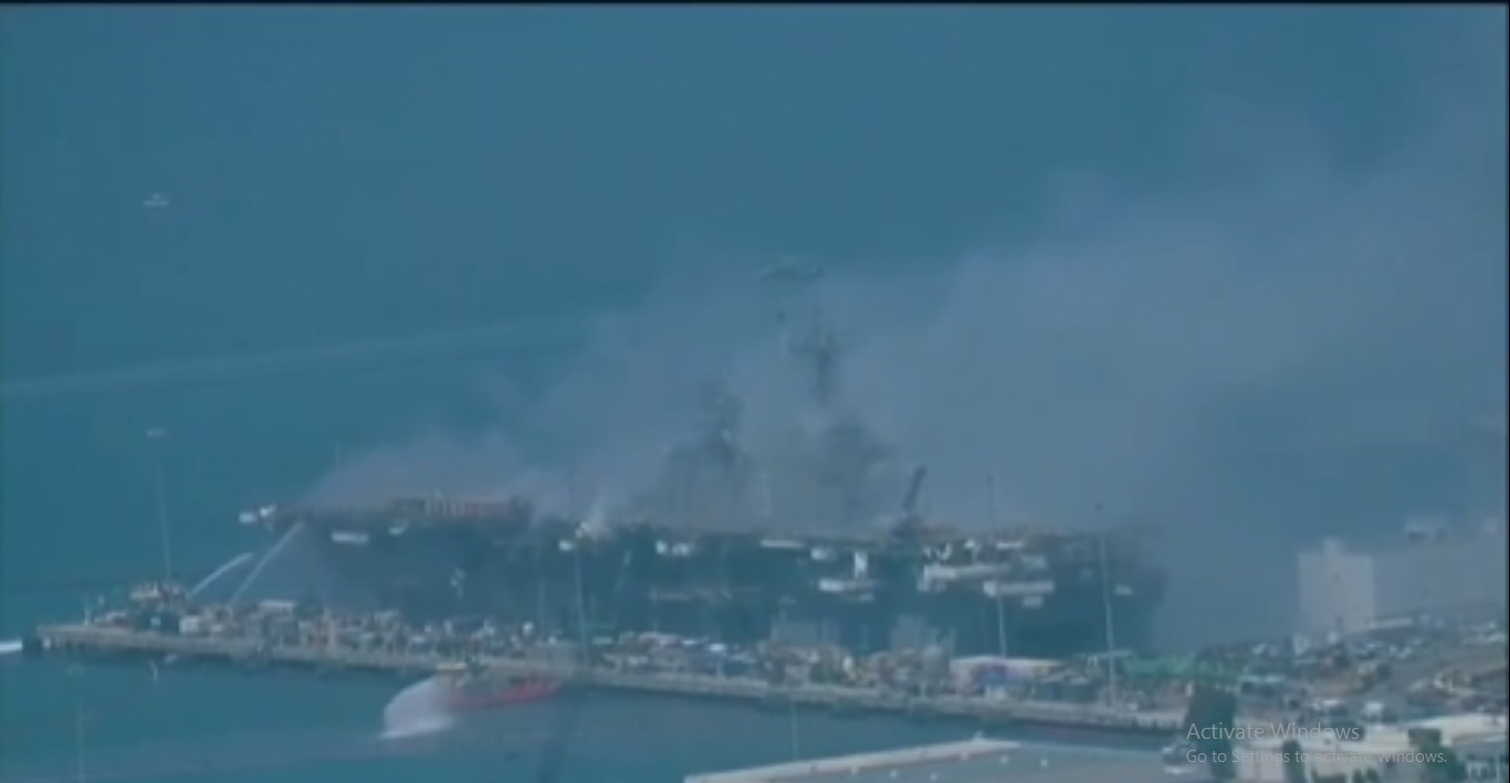 U.S. warship burning for a second day