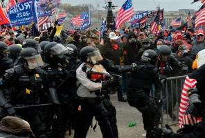 Fierce Capitol attacks on police in newly released videos