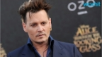Johnny Depp Rocks Out on Stage Amid Abuse Allegations