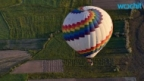 Giant Pig Hot Air Balloon Crashes After Tangling With a Cowboy-shaped One